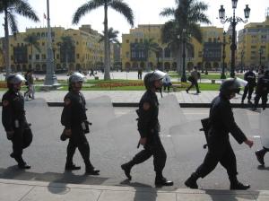 Police protect the Plaza de San Martin, Lima.