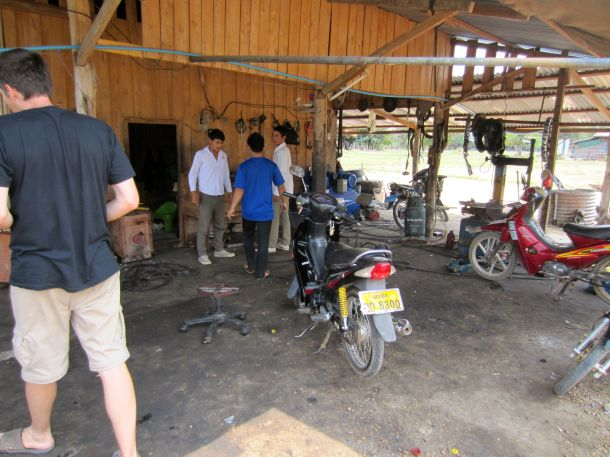 Motorcycle repair shop Laos motorbike flat tyre