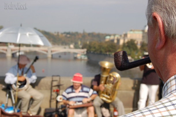 Man watching band on the charles bridge.