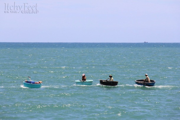 Bamboo basket boats float in the ocean.